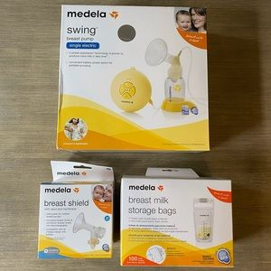 New Medela Swing Pump with Shield and Storage Bags